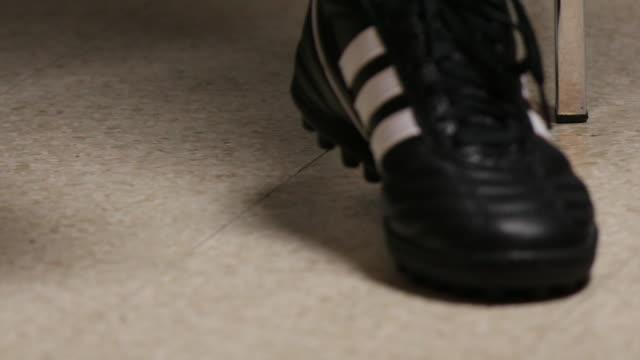 vídeos de stock e filmes b-roll de adidas football shoes. - remover