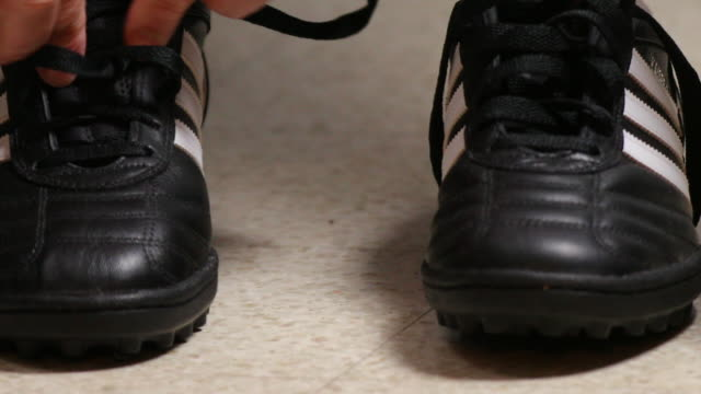 adidas football shoes. - studded stock videos and b-roll footage