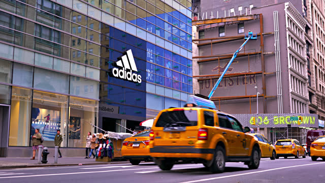 adidas shop. new york street. - yellow taxi stock videos & royalty-free footage
