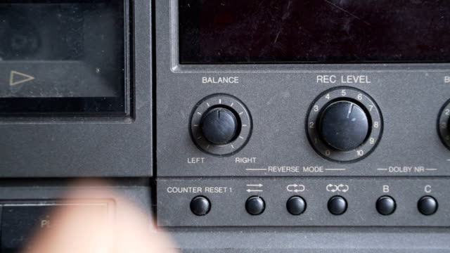 adjust the music by turning balance the volume by left human hand - knob stock videos and b-roll footage