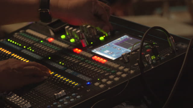 dj adjusting audio mixer at stage - live event stock videos & royalty-free footage