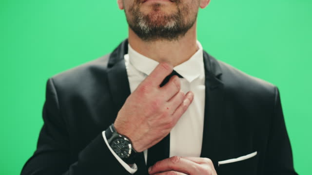 adjusting his tie to perfection - adjusting stock videos and b-roll footage