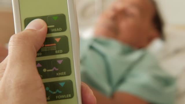 adjusting hospital electric bed - adjusting stock videos & royalty-free footage