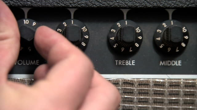 adjusting the volume - amplifier stock videos & royalty-free footage