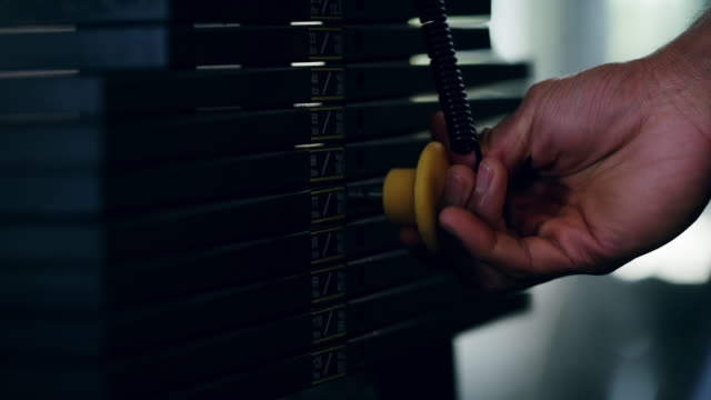 adjusting the weights accordingly - exercise machine stock videos & royalty-free footage