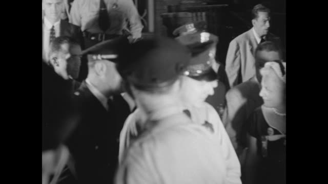 adlai stevenson faces boisterous press is escorted through crowd by police / stevenson with president harry s truman at podium / sot henry frederick... - adlai stevenson ii stock videos and b-roll footage