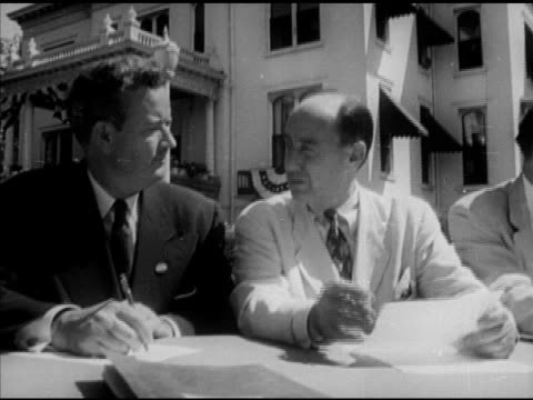 adlai stevenson ii sitting in the middle of long table w/ other males officials outdoors stevenson talking about first presidential campaign being... - adlai stevenson ii stock videos and b-roll footage