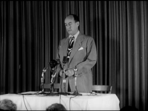 adlai stevenson ii speaking to press vs dwight 'ike' eisenhower deplaning greeting people raising hands ike riding convertible car through parade... - united states presidential election stock videos & royalty-free footage