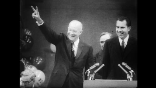 stockvideo's en b-roll-footage met / adlai stevenson speaks before democratic national convention / dwight eisenhower named at republican convention / huge crowd holding ike signs /... - 1956