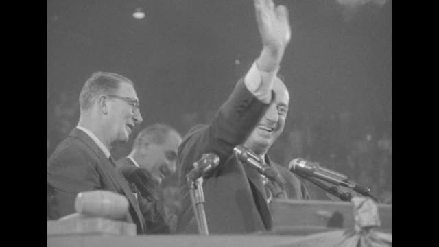 adlai stevenson's vp running mate estes kefauver at podium shaking hands with others on platform at democratic national convention at the... - sam rayburn video stock e b–roll