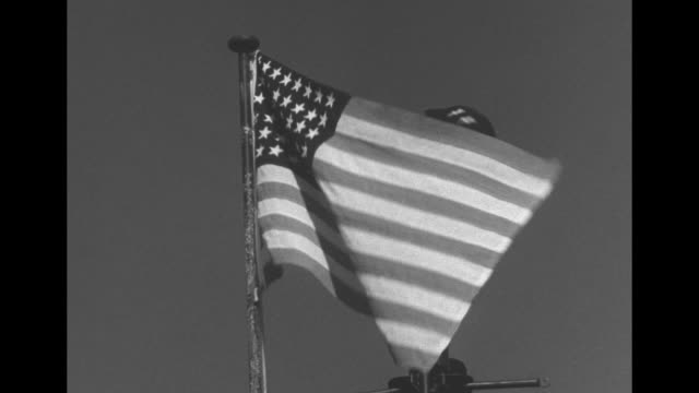 Adm Chester Nimitz American flag and US Navy 4Star admiral flag flutter in breeze / Nimitz with reporters / Nimitz Rear Admiral Thomas Withers...