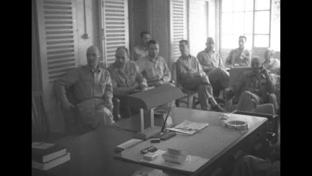 adm william halsey jr commander south pacific area and south pacific forces sitting with staff for photo opportunity in office / two shots of members... - william halsey stock-videos und b-roll-filmmaterial