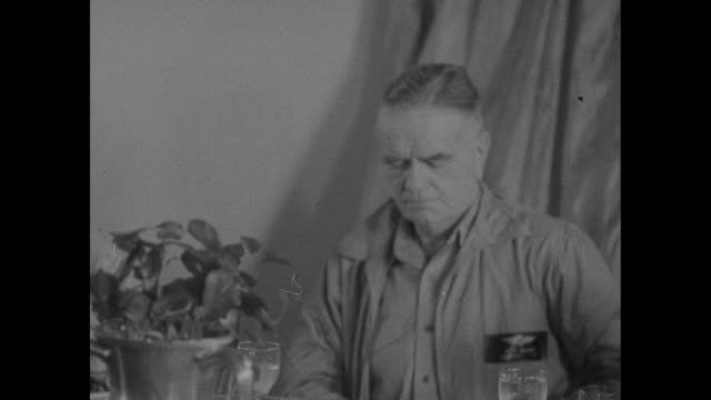 adm william halsey jr dines at a banquet on his flagship with us and british officers / cu steward applies frosting to cake decorated as the japanese... - william halsey stock-videos und b-roll-filmmaterial