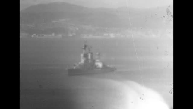 cu adm william halsey jr fleet commander saluting / sign on monument reading arturo prat tilt up to statue of prat chilean national hero / ws bay of... - william halsey stock-videos und b-roll-filmmaterial