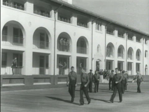 Administration building known as 'The Taj Mahal' VS Aviation cadet training program enlisted men in uniform walking near building other potential...