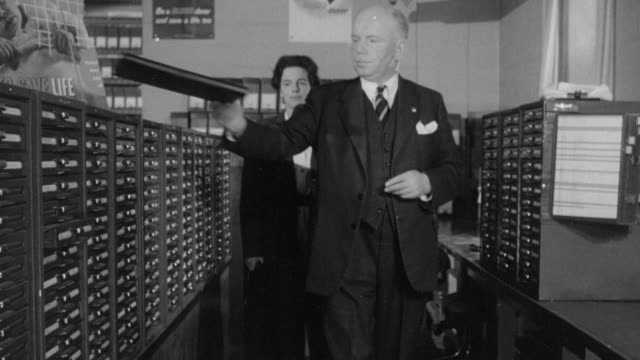 1958 ms administrator checking files in a drawer / united kingdom - open drawer stock videos & royalty-free footage