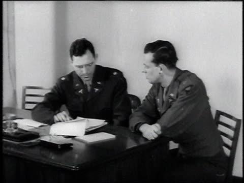 vídeos y material grabado en eventos de stock de administrator interviewing prospective veterans administration doctor / united states - 1946