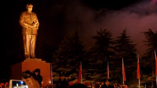 admiradores de mao zedong celebran este jueves el 120 aniversario del nacimiento del historico revolucionario chino voiced china conmemora... - mao stock videos and b-roll footage