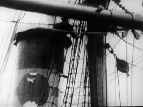 admiral byrd climbing up rigging of ship leaving on expedition to antarctica / newsreel - 1926 stock-videos und b-roll-filmmaterial