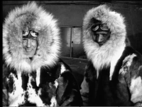 admiral byrd + floyd bennett in fur lined parkas after south pole flight - solo uomini di età media video stock e b–roll