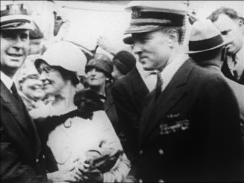 vidéos et rushes de admiral byrd on deck of ship docked in ny harbor before expedition / newsreel - 1926