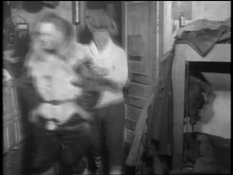admiral byrd other men in coats entering room smiling after flight to south pole - 1929 stock videos and b-roll footage