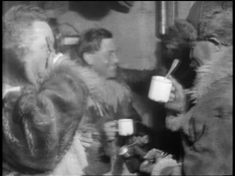 admiral byrd others drinking coffee talking after flight to south pole - 1929 stock videos and b-roll footage