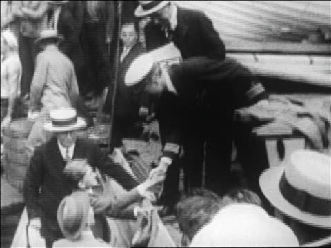 admiral byrd shaking hands with boy on ship before expedition to north pole / newsreel - new york harbor stock videos & royalty-free footage