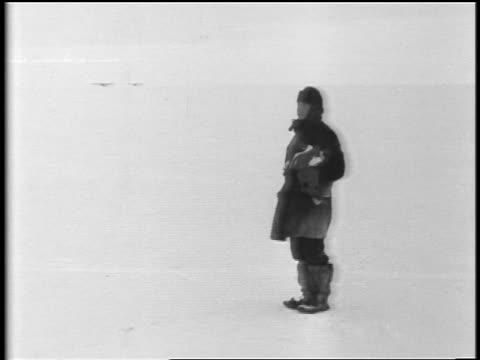 admiral byrd walking on snowy plain / turns waves to airplanes in distance walks away - 1929 stock videos and b-roll footage