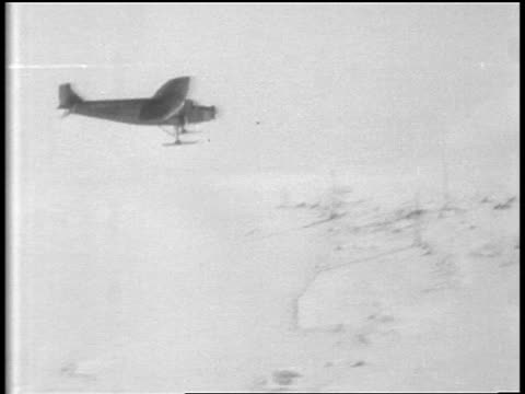admiral byrd's airplane flying over snowy plain / antarctica - 1929 stock videos and b-roll footage