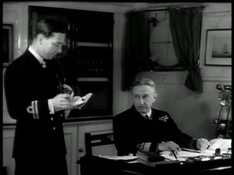 admiral flag on ship pole. int admiral sitting at desk w/ naval officer standing taking dictation . world war ii wwii - 1939 stock videos & royalty-free footage