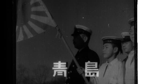 admiral mitsumi shimizu inspects tsingtao sea scouts of the third fleet dispatched to china members of the sea scouts carry wooden guns and file past... - carrying stock videos & royalty-free footage