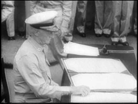 admiral nimitz sitting at table picking up pen / surrender of japan on uss missouri - uss missouri stock videos and b-roll footage