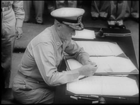 admiral nimitz sitting at table signing documents / surrender of japan on uss missouri - uss missouri stock videos and b-roll footage