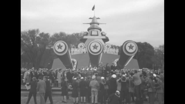admiral of the fleet chester nimitz mounts review stand strides to podium to join wife catherine takes off hat waves to crowd / crowd of mostly navy... - uss missouri stock videos and b-roll footage