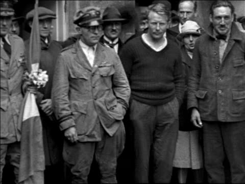 admiral richard e. byrd standing with others outdoors after trans-atlantic flight / france - anno 1925 video stock e b–roll