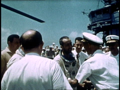 admiral william mccormick and his staff congratulating gemini iv astronauts / astronauts walking to elevator on their way to physical examination /... - splashdown stock videos and b-roll footage