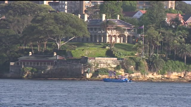 Admirality House and boats crossing Sydney harbour