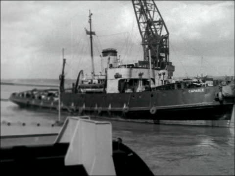 admiralty tug 'capable' england portsmouth portsmouth harbour ext general views of admiralty tug 'capable' / four officers standing on deck / 45 pm - hampshire england stock videos & royalty-free footage