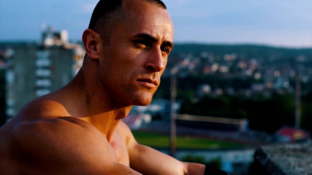 admire the view of the city in the sunset - shirtless stock videos & royalty-free footage