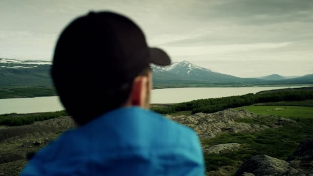 admiring icelandic nature - snowcapped mountain stock videos & royalty-free footage