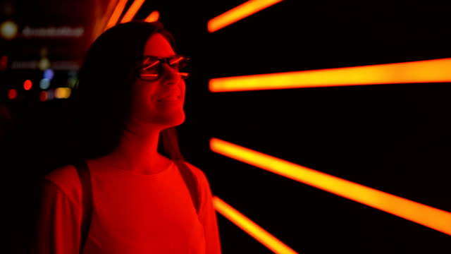 admiring neon lights - fluorescent stock videos & royalty-free footage