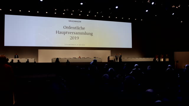 """admission to the audience in the hall of the event with sign with the inscription: """"annual general meeting 2019"""". german automaker volkswagen ag... - annual general meeting stock videos & royalty-free footage"""