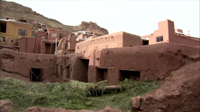 ws pan adobe houses, abyaneh, iran - adobe material stock videos and b-roll footage
