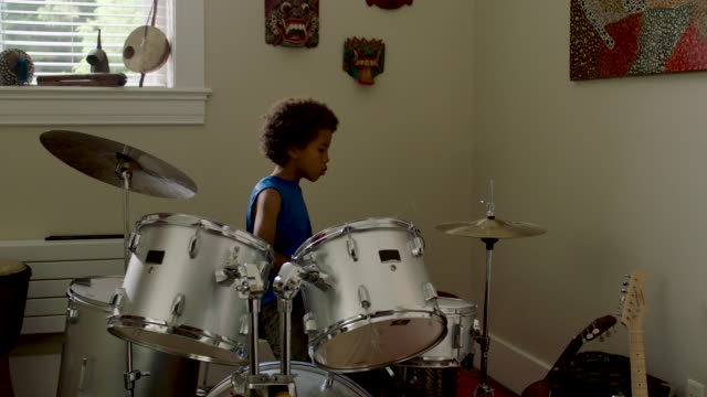 vidéos et rushes de adolescent boy plays drums at home - drummer