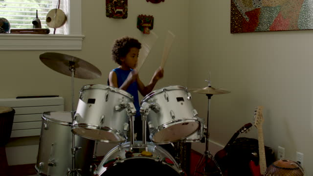 adolescent boy plays drums at home - leisure activity stock videos & royalty-free footage