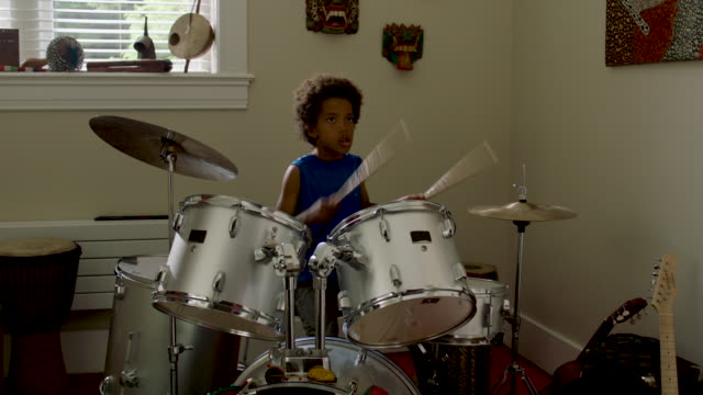 adolescent boy plays drums at home - drummer stock videos & royalty-free footage