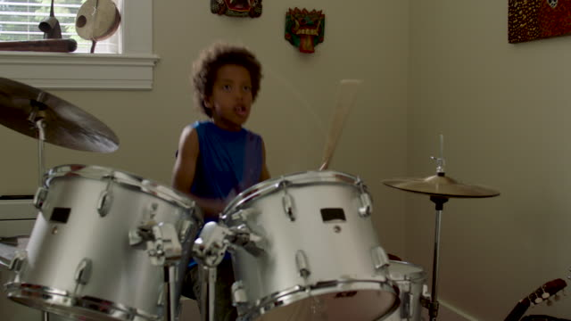 adolescent boy plays drums at home - drum percussion instrument stock videos & royalty-free footage