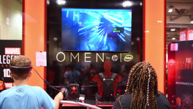 adolescent playing a game on a screen by branded omen by hp. the toronto fan expo is considered the largest comics, sci-fi, horror, anime, and gaming... - adolescence stock videos & royalty-free footage