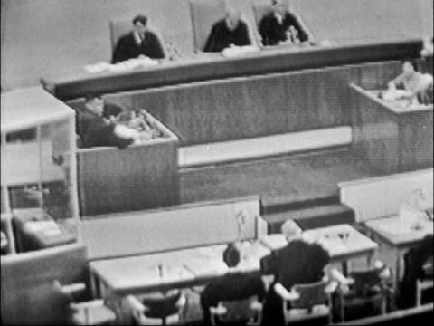 jerusalem int three presiding judges in courtroom pull adolf eichmann standing in bulletproof glass booth judges close shot eichmann wide view court... - prosecutor stock videos & royalty-free footage